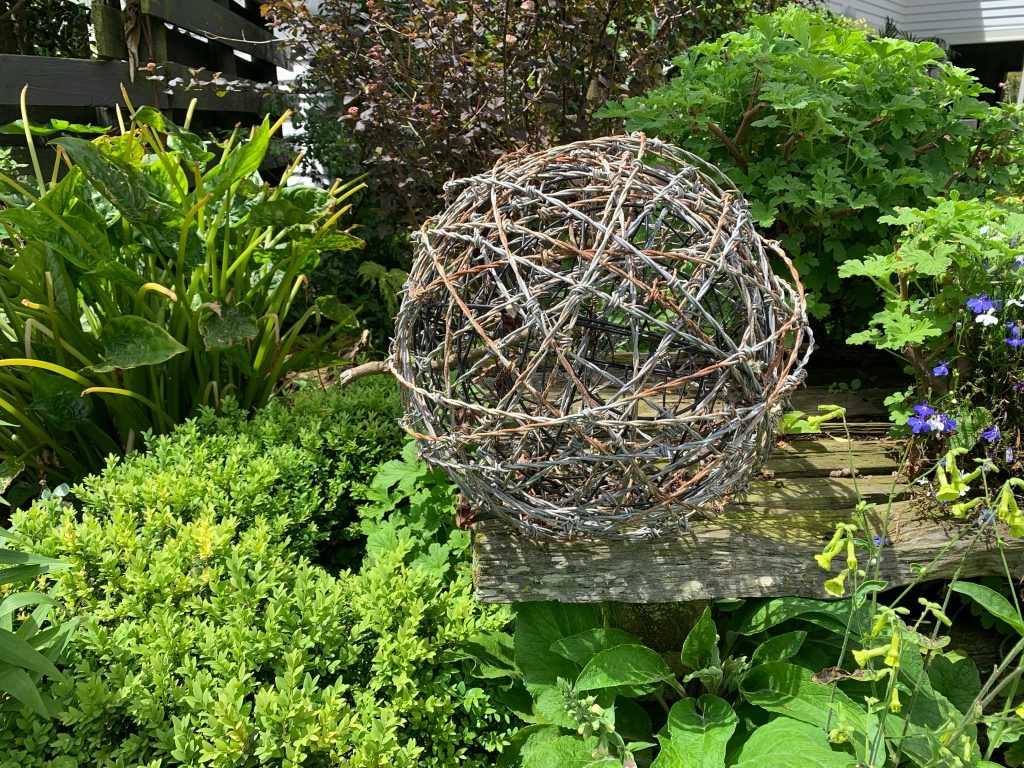 Decorative gsrfen sculpture created with barbed wire